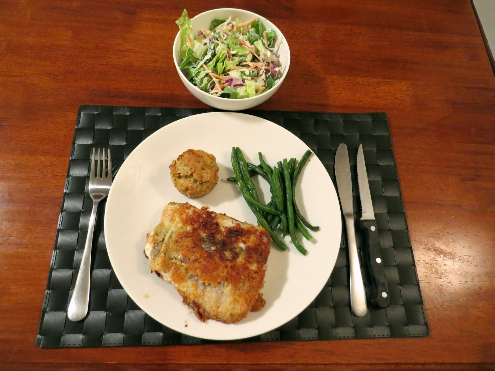 dinner of lightly battered and seasoned fish with egg and almond flour, sautéed in coconut and olive oil Barramundi, fresh organic green beans, homemade LC muffin, and salad