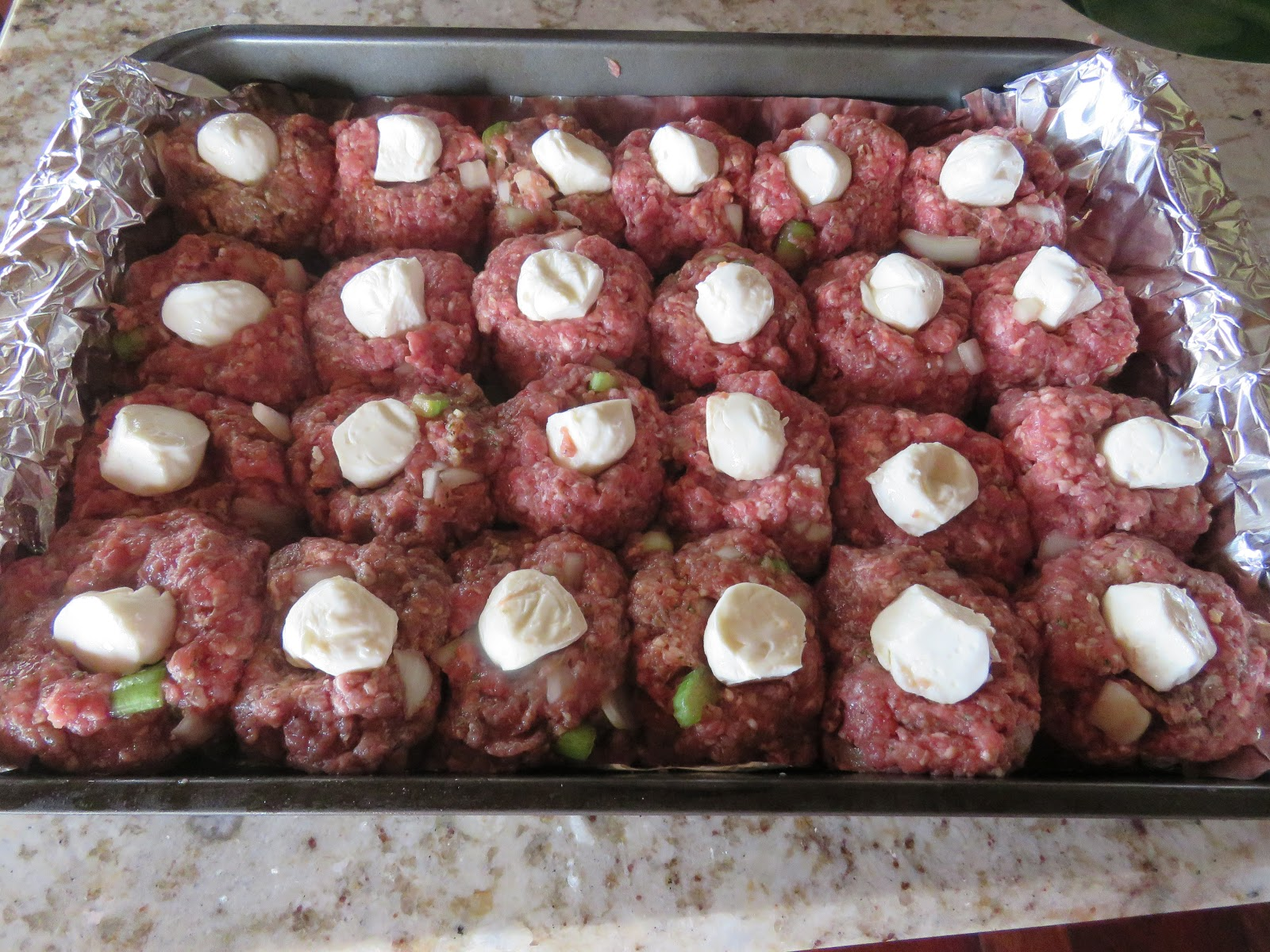 mozzarella balls, stuffed meatballs with a sugar-free Italian seasoned tomato sauce with mushrooms, topped with grated mozzarella cheese and Parmesan cheese
