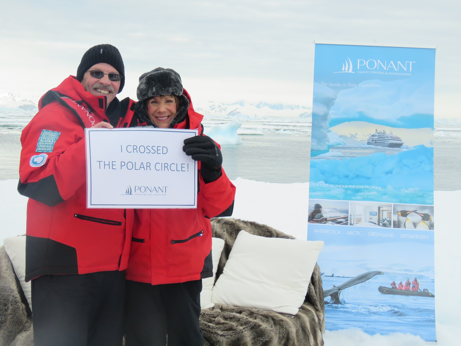 "Antarctica, both of us holding the ""I crossed the Polar Circle"" sign"